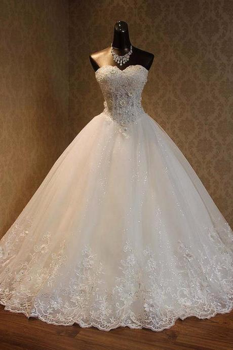 Lace Appliqués Tulle Wedding Gown Showcases Beaded Lace Embellished Sweetheart Bodice and Lace-Up Back